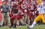 Arkansas safety Alan Turner returns an interception during the third quarter of a game Friday, Nov. 29, 2013 at Tiger Stadium in Baton Rouge, La. LSU won 31-27.