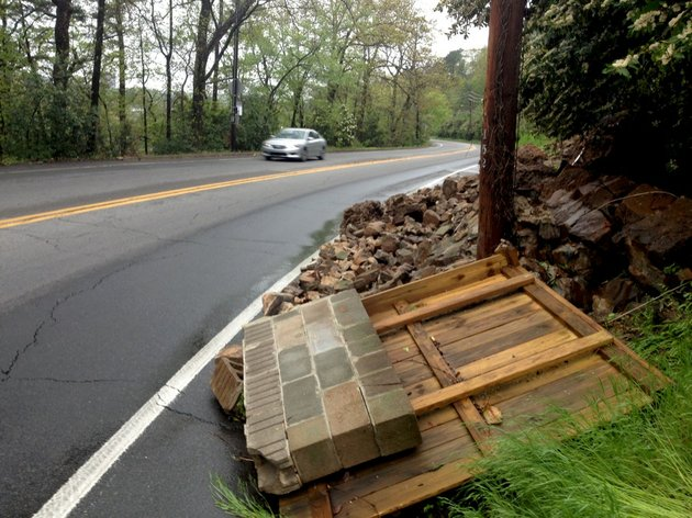 a-retaining-wall-on-kavanaugh-boulevard-in-little-rock-is-shown-crumbled-monday-morning-april-14-2014-after-heavy-rain-and-flash-flooding-the-night-before