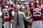 Alabama coach Nick Saban reacts to a breakdown with defensive players Alabama defensive back Jabriel Washington (23) and linebacker Dillon Lee (25) during Alabama's A-Day NCAA college football spring game Saturday, April 19, 2014, in Tuscaloosa, Ala. (AP Photo/Butch Dill)