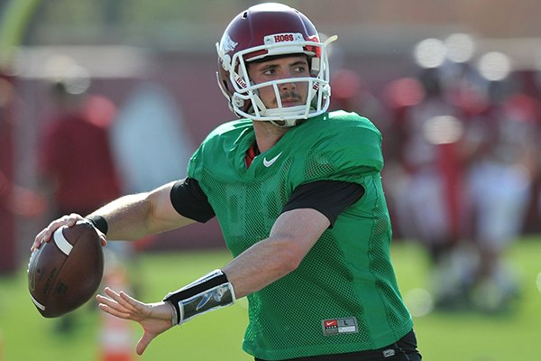 Arkansas quarterback Brandon Allen throws during a practice Thursday, April 11, 2014 in Fayetteville.