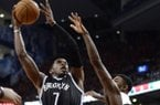 Brooklyn Nets' Joe Johnson, left, shoots over Toronto Raptors' Kyle Lowry (7) and during the second half of Game 7 of the opening-round NBA basketball playoff series in Toronto, Sunday, May 4, 2014. (AP Photo/The Canadian Press, Frank Gunn)