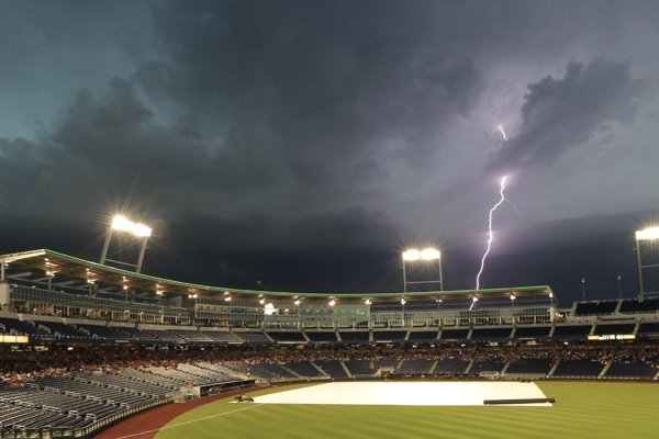 Lighting strikes near TD Ameritrade Park, during a weather delay in the baseball game between Virginia and Mississippi at the NCAA College World Series on Friday, June 20, 2014, in Omaha, Neb. (AP Photo/Northeast Mississippi Daily Journal, Thomas Wells)