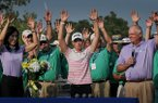 Stacy Lewis, right, holds up the trophy during a ceremony on the 18th green following the final round of the Walmart NW Arkansas Championship presented by P&G at Pinnacle Country Club in Rogers on Sunday, June 29, 2014.