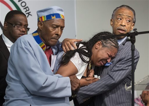 esaw-garner-center-wife-of-eric-garner-breaks-down-in-the-arms-of-rev-herbert-daughtry-and-rev-al-sharpton-right-during-a-rally-at-the-national-action-network-headquarters-for-eric-garner-saturday-july-19-2014-in-new-york-garner-43-died-thursday-during-an-arrest-in-staten-island-when-a-plain-clothes-police-officer-placed-him-in-what-appeared-be-a-chokehold-while-several-others-brought-him-to-the-ground-and-struggled-to-place-him-in-handcuffs