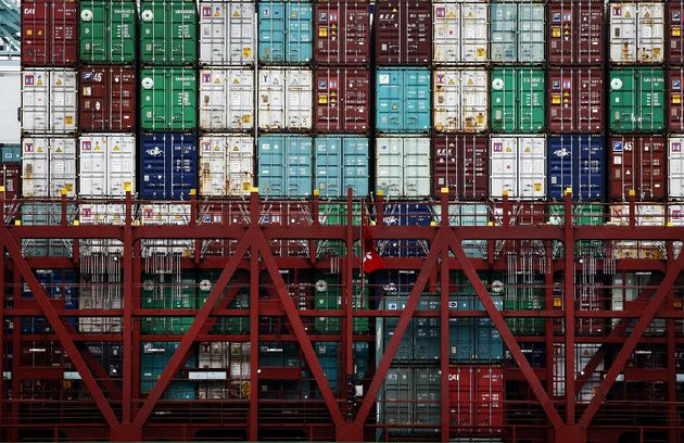 shipping-containers-sit-stacked-on-the-cscl-bohai-sea-container-ship-as-it-is-unloaded-at-the-port-of-los-angeles-in-san-pedro-california-us-on-monday-june-30-2014-a-six-year-labor-contract-expiring-between-about-20000-dockworkers-and-29-west-coast-ports-threatens-to-disrupt-trade-as-negotiators-scramble-to-forge-an-agreement-on-salaries-and-health-care-costs-photographer-patrick-t-fallonbloomberg