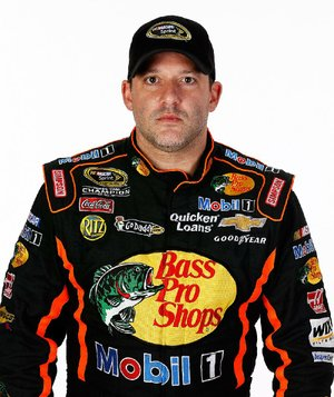 DAYTONA BEACH, FL - FEBRUARY 14:  Driver Tony Stewart poses during portraits for the 2013 NASCAR Sprint Cup Series at Daytona International Speedway on February 14, 2013 in Daytona Beach, Florida.  (Photo by Chris Graythen/NASCAR via Getty Images)