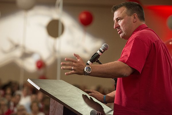 Arkansas coach Bret Bielema gives a few remarks Friday, Aug. 22, 2014 at the 2014 Arkansas Football Kickoff Luncheon at the Northwest Arkansas Convention Center in Springdale.