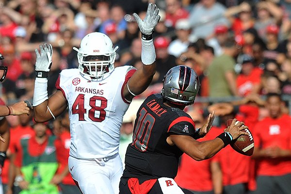 Arkansas defensive end Deatrich Wise Jr. pressures Rutgers quarterback Gary Nova on Saturday, Sept. 21, 2013 at High Point Solutions Stadium in Piscataway, N.J.
