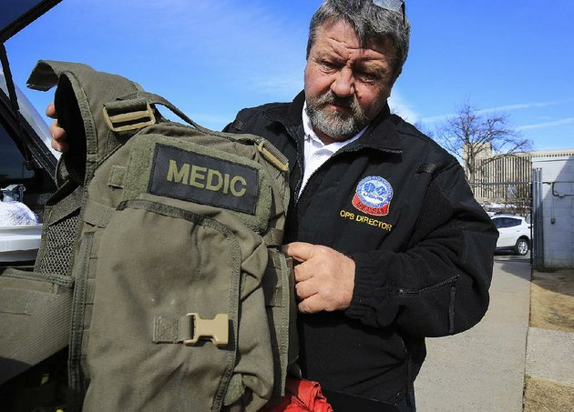 metropolitan-emergency-medical-services-director-of-operations-greg-thompson-displays-the-bullet-resistant-vest-he-wears-when-dispatched-with-law-enforcement-tactical-teams-tuesday-at-mems-headquarters-in-little-rock-mems-is-seeking-to-buy-less-cumbersome-ballistic-vests-for-its-medics