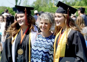 Photo by Randy Moll The Krewson twins, Alex and Abbi, posed for a photo with their mother following graduation ceremonies on Saturday.