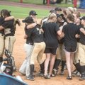 De Queen players celebrate their 4-1 win over Valley View in the 5A state softball championship game...