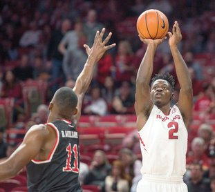 NWA Democrat-Gazette/Ben Goff SURPRISE DEFENDER: Adrio Bailey, Arkansas forward, shoots as Bryson Williams, Fresno State forward, defends in the first half Nov. 17 at Bud Walton Arena in Fayetteville. The 6-5 forward leads the Razorbacks with 13 blocks.