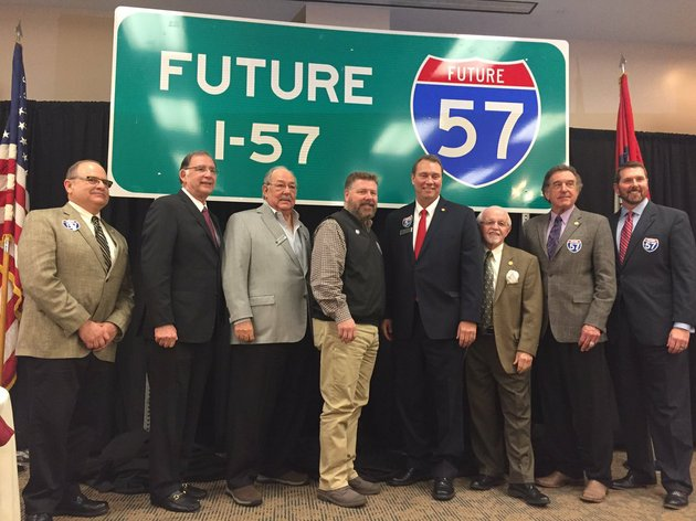 officials-pose-with-sign-designating-home-of-future-interstate-57-on-friday-feb-23-2018