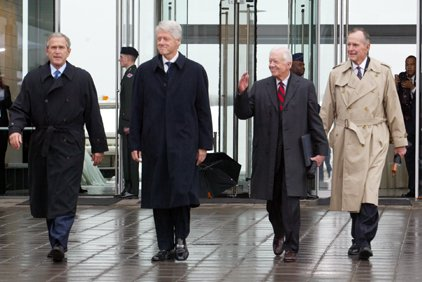 president-george-w-bush-former-presidents-bill-clinton-jimmy-carter-and-george-h-w-bush-walk-toward-the-speakers-platform-before-the-clinton-library-dedication-in-little-rock-in-this-2004-file-photo