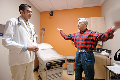 Help With Medical Bills >> Medical student Pintu Amratlal (left) listens as M.D. Graham portrays ...