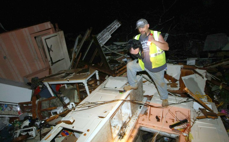 Tornadoes touch down in Arkansas, kill 9