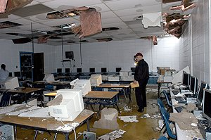 james-m-warren-with-the-pulaski-county-special-school-district-surveys-the-damagein-the-computer-lab-at-sylvan-hills-high-school-on-friday-shhs-suffered-damage-due-to-a-possible-tornado-late-thursday-evening