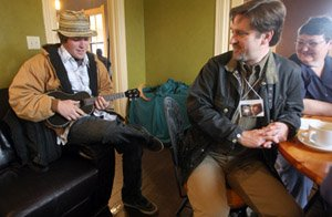 jody-hughes-plays-ukulele-for-the-benefit-of-cafe-patrons-at-a-mixer-for-ozark-foothills-filmfest-guests-including-sean-tracey-and-sandy-qualls-tracey-second-from-right-is-a-filmmaker-from-new-hampshire-who-traveled-to-batesville-to-screen-his-documentary-the-jesus-guy