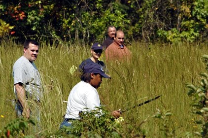 terrylyn-aaron-center-martin-marter-and-other-members-of-the-pulaski-county-sheriffs-office-search-a-wooded-area-along-oldfield-lane-in-pulaski-county-near-jacksonville-on-wednesday-afternoon