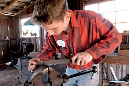 charlie-casey-from-beebe-files-down-and-sharpens-the-point-of-a-turning-fork-he-forged-out-of-wrought-iron-in-the-blacksmith-shop-during-the-scott-plantation-settlements-high-cotton-on-the-bayou-event-in-this-2006-file-photo