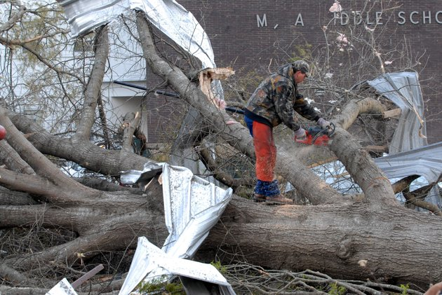 workers-clear-down-trees-near-the-polk-county-courthouse-in-downtown-mena-on-friday-morning-a-tornado-tore-through-mena-late-thursday-night-damaging-or-destroying-much-of-downtown