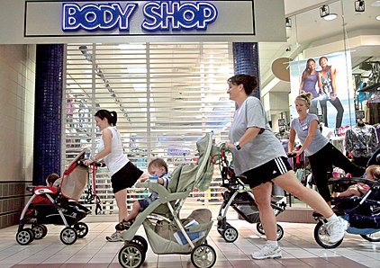stroller-strides-students-from-left-lauren-sanders-rebecca-mc-cormick-and-shannon-jackson-do-hamstring-presses-while-pushing-their-children-around-mccain-mall