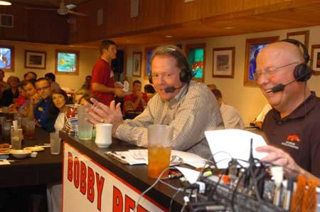Arkansas head coach Bobby Petrino, left, talks during his radio show with host Chuck Barrett Wednesday at the Catfish Hole in Fayetteville.