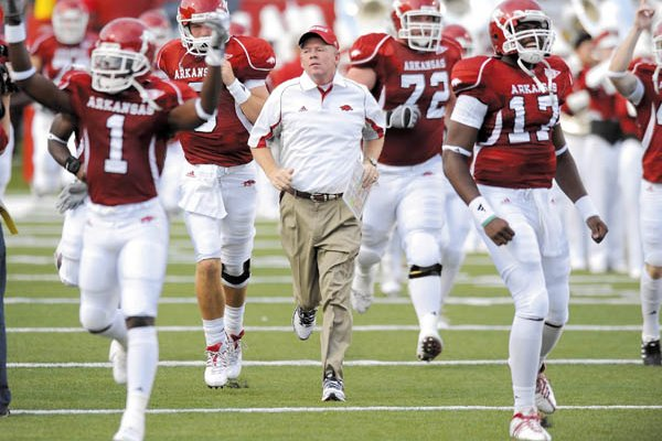 Arkansas coach Bobby Petrino runs through the 'A' with his team prior to the start of the Hogs' 48-10 win over Missouri State Sept. 5 in War Memorial Stadium in Little Rock.