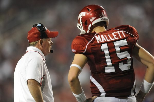 Arkansas sophomore quarterback Ryan Mallett, right, speaks to coach Bobby Petrino during the Hogs' 52-41 loss to Georgia Sept. 19 in Razorback Stadium.