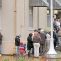 A long line of people stretched around the corner in front of the Benton County Courthouse Annex in ...