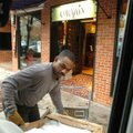 Brian Wellman unloads a shipment of art and furniture Monday into the store Corazon on the Fayettevi...