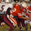 Farmington senior safety Logan Boudrey (2) and sophomore linebacker Deon Clay tackle Hunstville juni...