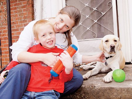 christy-etters-her-6-year-old-son-jackson-and-his-dog-chester-take-a-break-on-the-steps-of-their-home-in-conway-the-autism-service-dog-which-cost-13500-was-purchased-in-oregon-a-conway-man-whose-son-also-is-autistic-helped-lead-fundraising-efforts
