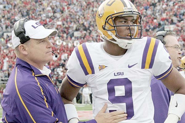 LSU Coach Les Miles, talking to quarterback Jordan Jefferson during Saturday's 25-23 loss to Mississippi, spent the weekend second-guessing his strategy in the closing moments of the game and accepted responsibility for the loss in Monday's weekly news conference.