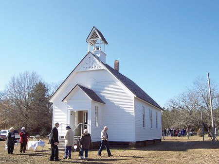 a-group-of-people-walk-around-the-outside-of-the-smyrna-church-in-searcy-during-a-walk-through-history-program-sponsored-by-the-arkansas-historic-preservation-program-in-cooperation-with-the-white-county-historical-society-and-the-searcy-arts-council-built-in-1856-57-smyrna-church-is-the-oldest-documented-church-building-in-arkansas