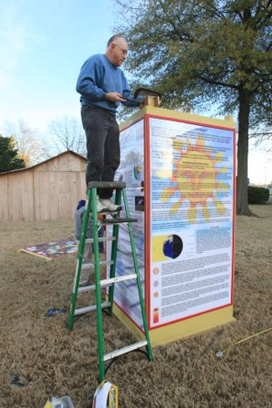 FILE — Mark Love of the Arkansas Society of Freethinkers works Wednesday, December 16, 2009 to set up a winter solstice display on the grounds of the state Capitol. A federal judge ruled that the secretary of state's office must let the group set up their display.