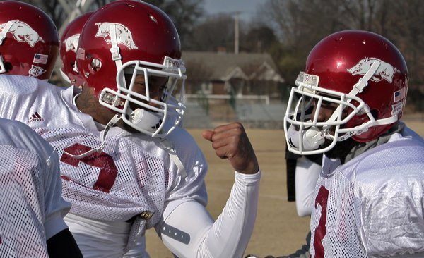 Wide receivers London Crawford, left, and Joe Adams joke around during practice at Rhodes College in Memphis in preparation for the Liberty Bowl. Adams, a sophomore, has caught 7 touchdown passes. Crawford, a senior, hasn't caught a touchdown this season.