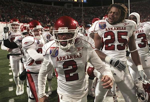 arkansas-kicker-alex-tejada-is-surrounded-by-teammates-after-kicking-a-game-winning-field-goal-in-overtime-to-beat-east-carolina-20-17-in-the-liberty-bowl