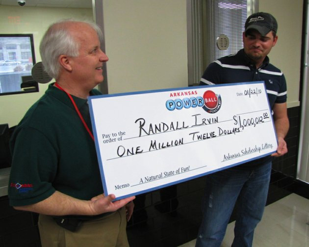 uniontown-resident-randall-irvin-and-arkansas-scholarship-lottery-vice-president-of-gaming-david-barden-pose-with-an-oversized-check-friday-marking-irvins-1-million-powerball-win