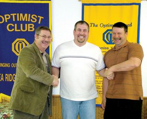 Mayor Jackie Crabtree and Optimist Club president Merrill White bid Brian Nave farewell at a recent Optimist Club meeting.