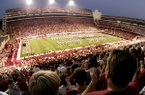The stands at Reynolds Razorback Stadium are packed for a 2004 Razorbacks home football game. Ticket prices for conference games are going up this 2010 season, the university has announced.