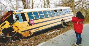 Morgan Bowen, 15, a sophomore at Heritage High School was one of six students on a Rogers school bus which wrecked on Ventris Road Friday morning. Morgan took a photograph of the bus with her cell phone.