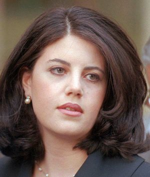 FILE--Former White House intern Monica Lewinsky leaves the Wanamaker Building in Philadelphia in this April 6, 1998, file photo.