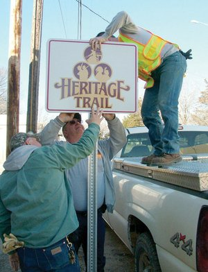 Identifying the rich historical heritage of the trails of the Pea Ridge area, Heritage Trail signs were erected recently by Pea Ridge Street Department employees Larry Majors, Nathan See and Tommy Thompson.