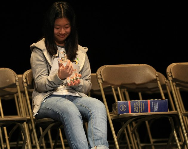 esther-park-14-looks-at-her-trophy-after-winning-the-arkansas-democrat-gazette-spelling-bee-saturday-at-the-university-of-arkansas-little-rock-park-representing-pulaski-county-also-won-the-event-last-year