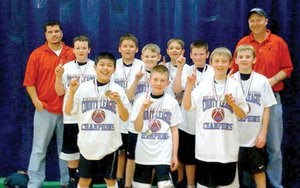 Fifth-grade basketball boys won first place in the Mayb Basketball Tournament Feb. 27-28. They include front row, from left: Garrett King, Logan Johnson and Joey Hall; and back, from left: coach Jarred Linam, Chandler Tidwell, Britton Caudill, Austin Anderson, Bryce Prince, Westin Church, Cole Wright and coach Kevin Hall.