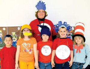 Students and their teacher show off their costumes during the recent Dr. Seuss celebration.
