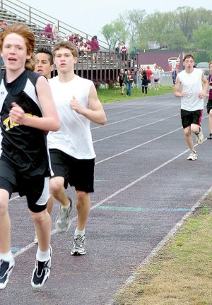 Jr. Blackhawk track members Dayton Winn, third from left, and Justin Samples, right, competed at Gentry Friday.