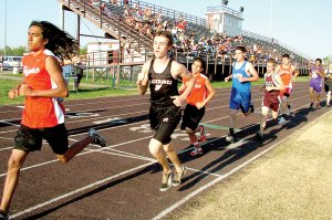 Colton Holtgrewe crosses the finish line in the Gentry track meet last week. Holtgrewe placed twice — eighth in the 1600 and sixth in the 3200.