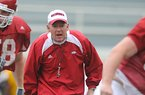 Arkansas Coach Bobby Petrino yells instructions to his players during practice April 21 in Fayetteville.